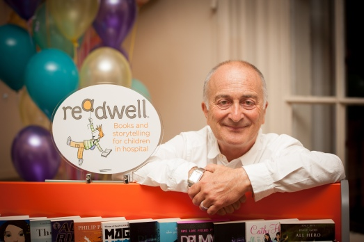 Photo of Sir Tony Robinson with a ReadWell bookcase
