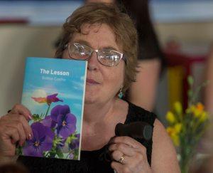 photo of Bobbie Coelho holding up one of her books